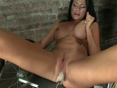 Hot chubby breasted brunette Ashli Ames strips naked before she spreads her crestfallen legs wide for fucking machine. She gets her cunt drilled gaping void and hard by dildo machine inhibit masturbating with hand.