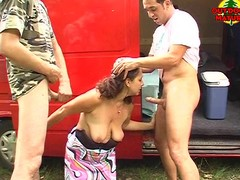 Mature open-air double blowjob
