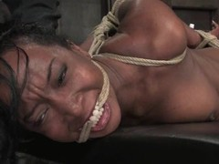 Luscious ebony slut gets tied up and tortured