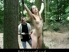 Skinny blonde menial girl experiences a kinky bdsm game in the forest